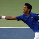 India's Somdev Devvarman returns a shot to Serbia's Dusan Lajovic during their Davis Cup tennis World Group play-off tie between India and Serbia, in Bangalore, India, Sunday, Sept. 14, 2014. (AP Photo/Aijaz Rahi)