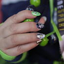A Seattle Seahawks fan shows her fingernails before the NFL Super Bowl XLIX football game between the Seahawks and the New England Patriots on Sunday, Feb. 1, 2015, in Glendale, Ariz The Associated Press