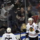 Chicago Black Hawks center Andrew Shaw (65) celebrates with center Jonathan Toews (19) after Toews scored the game winning goal during the third period of an NHL hockey game against the Buffalo Sabres in Buffalo, N.Y., Sunday, March 9, 2014. Chicago won