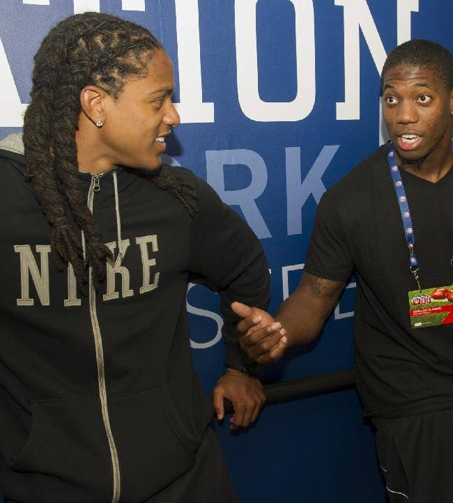 Cincinnati Bengals rookie Darqueze Dennard, right, talks with San Diego Chargers rookie Jason Verrett, left,  during the 2014 NFL Rookie Symposium at the Pro Football Hall of Fame in Canton, Ohio, Saturday, June 28, 2014