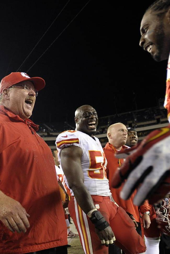 Kansas City Chiefs coach Andy Reid reacts after being doused in the final minutes of the Chiefs' NFL football game against the Philadelphia Eagles, Thursday, Sept. 19, 2013, in Philadelphia. Kansas City won 26-16