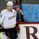 "FILE - In this Jan. 22, 2011, file photo, Anaheim Ducks' Saku Koivu skates by sign reading ""KOIVU #1"" before an NHL hockey game against the Montreal Canadiens in Montreal. The NHL players association announced on Wednesday, Sept. 10, 2014, that the Finnish star would call it a career after 18 seasons, all but five of which were spent in Montreal. He won four Olympic medals with Finland in the Winter Olympics, including a silver in their 2006 loss to archrival Sweden in the final. (AP Photo/The Canadian Press, Graham Hughes, File)"