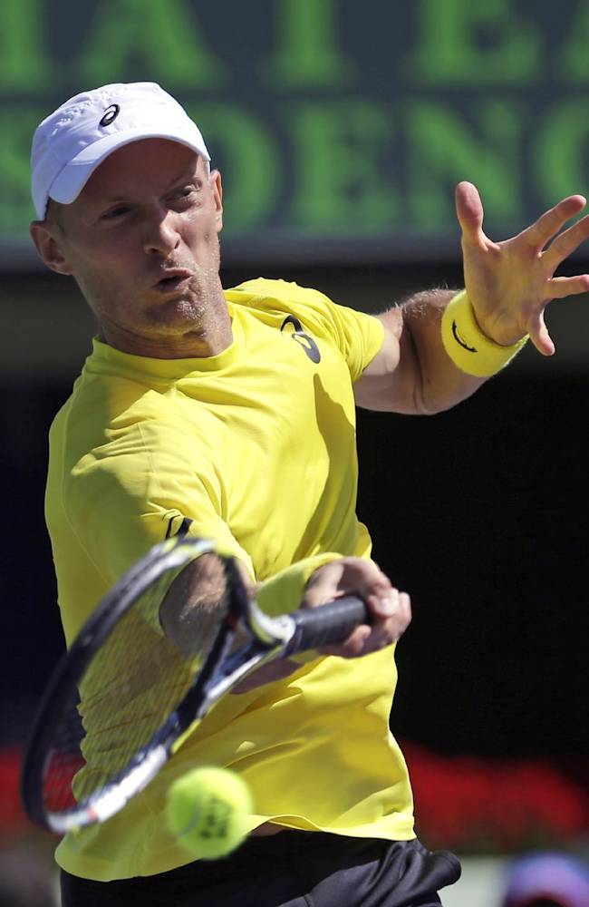Nikolay Davydenko, of Russia, returns to Adrian Mannarino, of France, during the first round at the Sony Open tennis tournament at Key Biscayne, Fla., Wednesday, March 19, 2014