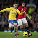 Manchester United s Robin van Persie, right, fights for the ball against Arsenal s Laurent Koscielny during their English Premier League soccer match at Old Trafford Stadium, Manchester, England, Saturday Nov. 10, 2013