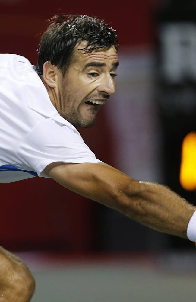 Ivan Dodig of Croatia returns the ball against Milos Raonic of Canada during their semifinal match of the Japan Open Tennis Championships, in Tokyo, Saturday, Oct. 5, 2013