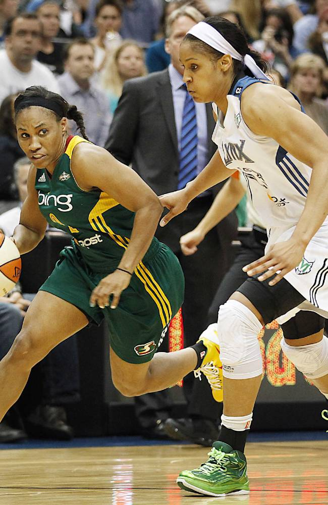 Seattle Storm guard Temeka Johnson (2) pushes the ball past Minnesota Lynx forward Maya Moore (23) in the opening game of a first-round WNBA basketball playoff series, Friday, Sept. 20, 2013, in Minneapolis. The Lynx won 80-64