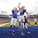 Buffalo Bills wide receiver Chris Hogan, left, and wide receiver Robert Woods celebrate Hogan's touchdown catch against the Cleveland Browns during the second half of an NFL football game, Sunday, Nov. 30, 2014, in Orchard Park, N.J The Associated Press