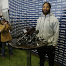 Seattle Seahawks defensive end Michael Bennett talks to reporters Monday, March 10, 2014, at the team's headquarters in Renton, Wash. The Seahawks announced Monday that Bennett, who was one of the top NFL football free agents this year, had signed a multi