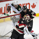 Minnesota Wild left wing Dany Heatley pushes the puck past Ottawa Senators goalie Craig Anderson and Erik Karlsson (65) during the second period of an NHL hockey game in Ottawa, Ontario on Wednesday, Nov. 20, 2013 The Associated Press