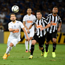 Cruzeiro's Everton Ribeiro, left, fights for the ball with Atletico Mineiro's Leandro Donizete, center, while Maicosuel looks on during the Brazilian Cup final soccer match in Belo Horizonte, Brazil, Wednesday, Nov. 26, 2014