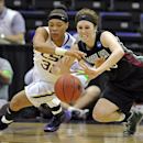 LSU guard Danielle Ballard, left, and Green Bay guard Adrian Ritchie, right, dive for a loose ball during the first half of a first-round game in the women's NCAA college basketball tournament at the Pete Maravich Assembly Center in Baton Rouge, La., Sunday, March 24, 2013. (AP Photo/Bill Feig)