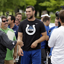 Indianapolis Colts quarterback Andrew Luck jokes with the media as he walks away from an interview as the players arrived for the NFL team's football training camp in Anderson, Ind., Wednesday, July 23, 2014 The Associated Press