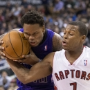 Sacramento Kings' Ben McLemore, left, drives at Toronto Raptors' Kyle Lowry during second half NBA basketball action in Toronto on Friday March 7, 2014 The Associated Press