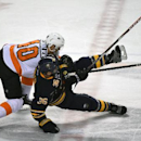 Philadelphia Flyers center Vincent Lecavalier (40) checks Buffalo Sabres right winger Patrick Kaleta (36) during the third period of an NHL hockey game Saturday, Jan. 17, 2015, in Buffalo, N.Y. The Flyers won 4-3 The Associated Press