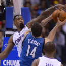 Los Angeles Clippers center DeAndre Jordan, left, fouls Minnesota Timberwolves center Nikola Pekovic, of Montenegro, during the first half of an NBA basketball game, Monday, Nov. 11, 2013, in Los Angeles The Associated Press