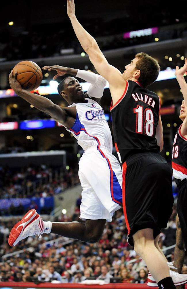 Los Angeles Clippers guard Darren Collison, left, drives on Portland Trail Blazers forward Victor Claver (18), of Spain, as he goes to the basket in the second half of a pre-season NBA basketball game, Friday, Oct. 18, 2013, in Los Angeles. The Trail Blazers won 94-84
