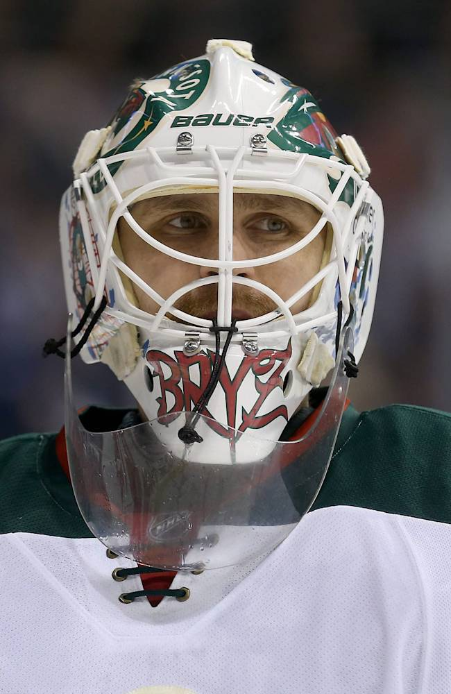 Minnesota Wild's Ilya Bryzgalov (30) takes a breather during a commercial break while playing against the Winnipeg Jets during second period NHL hockey action in Winnipeg,  Manitoba, Monday, April 7, 2014