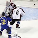 St. Louis Blues' Derek Roy (12) scores past Colorado Avalanche goalie Jean-Sebastien Giguere and Jan Hejda (8), of the Czech Republic, during the first period of an NHL hockey game Thursday, Nov. 14, 2013, in St. Louis The Associated Press