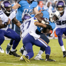 Tennessee Titans running back Antonio Andrews is tackled by Minnesota Vikings corner back Shaun Prater during the Titans' 19-3 preseason loss to the Vikings at LP Field on Thursday, Aug. 28, 2014 The Associated Press