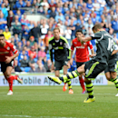 Stoke City's Marko Arnautovic scores his side's first goal of the game from the penalty spot during their English Premier League soccer match against Cardiff City at the Cardiff City Stadium, Cardiff, Wales, Saturday, April 19, 2014
