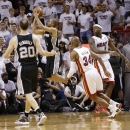 San Antonio Spurs point guard Tony Parker (9) makes the final shot of the game against the Miami Heat during the second half of Game 1 of the NBA Finals basketball game, Thursday, June 6, 2013 in Miami. (AP Photo/Lynne Sladky)