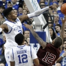 Kentucky's Nerlens Noel, left, blocks the shot of Texas A&M's Fabyon Harris as Kentucky's Ryan Harrow watches during the first half of an NCAA college basketball game at Rupp Arena in Lexington, Ky., Saturday, Jan. 12, 2013. (AP Photo/James Crisp)