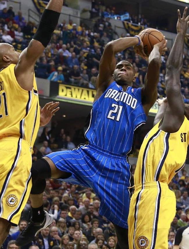Orlando Magic forward Maurice Harkless (21) attempts a shot while defended by Indiana Pacers forward David West, left, and guard Lance Stephenson, right, in the first half of an NBA basketball game in Indianapolis, Tuesday, Oct. 29, 2013