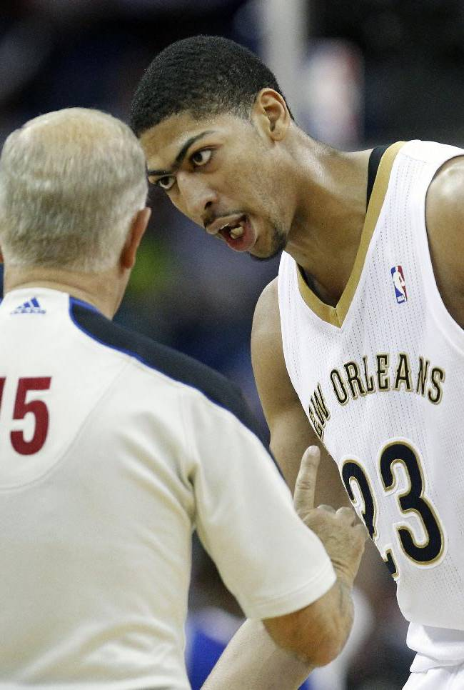 New Orleans Pelicans forward Anthony Davis (23) talks with NBA official Bennett Salvatore (15) after Salvatore called a technical on Davis late in the second half of an NBA basketball in New Orleans, Monday, Feb. 24, 2014. The Clippers won 123-110