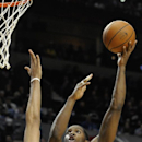 Brooklyn Nets' Joe Johnson (7) shoots against Portland Trail Blazers' Nicolas Batum (88) during the first half of an NBA basketball game in Portland, Ore., Wednesday, Feb. 26, 2014 The Associated Press