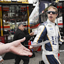 Driver Brad Keselowski signs autographs as he heads out after practice for the NASCAR Sprint Cup auto race at New Hampshire Motor Speedway, Saturday, Sept. 20, 2014, in Loudon, N.H. (AP Photo/Cheryl Senter)