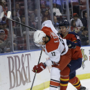 Carolina Hurricanes center Eric Staal (12) and Florida Panthers center Nick Bjugstad (27) battle for the puck in the first period of an NHL hockey game, Wednesday, Nov. 26, 2014, in Sunrise, Fla The Associated Press