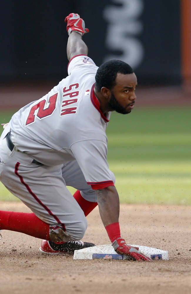 Washington Nationals' Denard Span loses his helmet while sliding into second on an eighth-inning double against the New York Mets during a baseball game on Thursday, Sept. 12, 2013, in New York