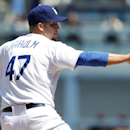 Los Angeles Dodgers pitcher Paul Maholm throws against the San Francisco Giants in the first inning of a baseball game on Saturday, April 5, 2014, in Los Angeles The Associated Press