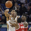 New Orleans Pelicans forward Anthony Davis (23) passes the ball over Milwaukee Bucks guard Brandon Knight (11) during the first half of an NBA basketball game in New Orleans, Friday, March 7, 2014 The Associated Press