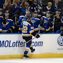 St. Louis Blues' Kevin Shattenkirk (22) is congratulated by the Blues' bench after his goal against the Vancouver Canucks during the second period of an NHL hockey game, Thursday, Oct. 23, 2014, in St. Louis The Associated Press