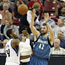 Minnesota Timberwolves forward Kevin Love (42) passes the ball over Sacramento Kings defender Jason Thompson during the second half of an NBA basketball game in Sacramento, Calif., on Sunday, April 13, 2014. The Kings won 106-103 The Associated Press