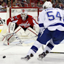 Washington Capitals goalie Braden Holtby (70) prepares to defend a shot by Tampa Bay Lightning center Cedric Paquette (54) in the second period of an NHL hockey game on Sunday, April 13, 2014, in Washington The Associated Press