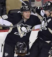 Pittsburgh Penguins' Jussi Jokinen (36) celebrates his goal with Evgeni Malkin (71) in the first period of an NHL hockey game between the Pittsburgh Penguins and the Montreal Canadiens in Pittsburgh, Wednesday, Jan. 22, 2014. (AP Photo/Gene J. Puskar)