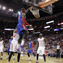 Detroit Pistons forward Josh Smith (6) dunks as Houston Rockets' Dwight Howard, left, and Jordan Hamilton (5) watch during the first half of an NBA basketball game, Saturday, March 1, 2014, in Houston The Associated Press