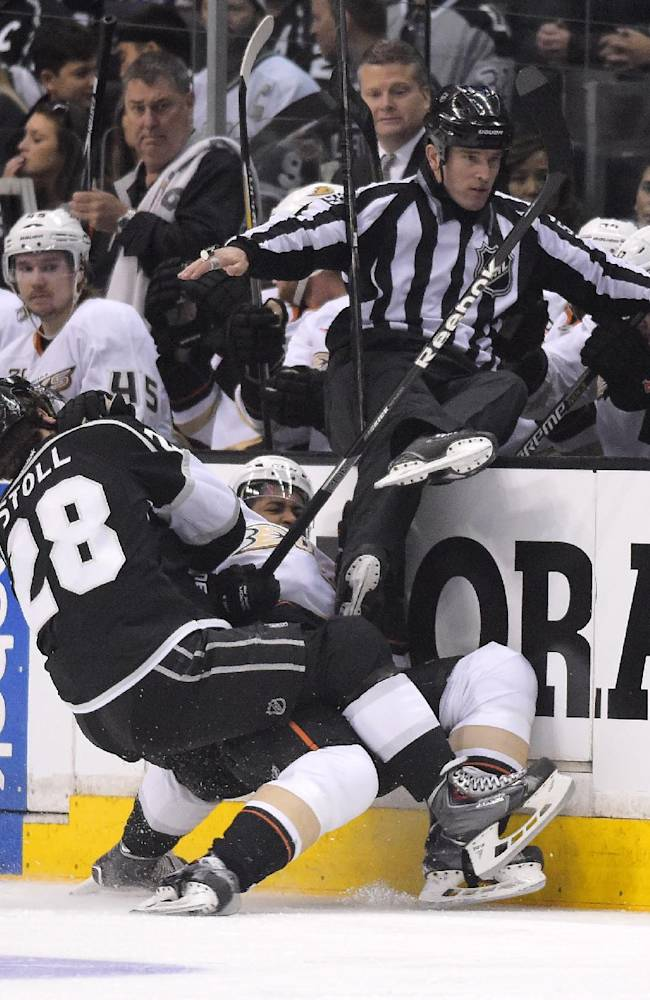 Los Angeles Kings center Jarret Stoll, left, and Anaheim Ducks right wing Devante Smith-Pelly collide during the first period in Game 4 of an NHL hockey second-round Stanley Cup playoff series, Saturday, May 10, 2014, in Los Angeles