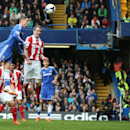 Chelsea's Fernando Torres, top left, rises above the Stoke City's defense to head the ball towards goal during their English Premier League soccer match between Chelsea and Stoke City at Stamford Bridge stadium in London, Saturday, April, 5, 2014