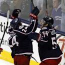 Columbus Blue Jackets' Derek MacKenzie, left, and Mark Letestu celebrate MacKenzie's goal against the Detroit Red Wings in the third period of an NHL hockey game in Columbus, Ohio, Tuesday, March 11, 2014. Columbus won 4-1. (AP Photo/Paul Vernon)