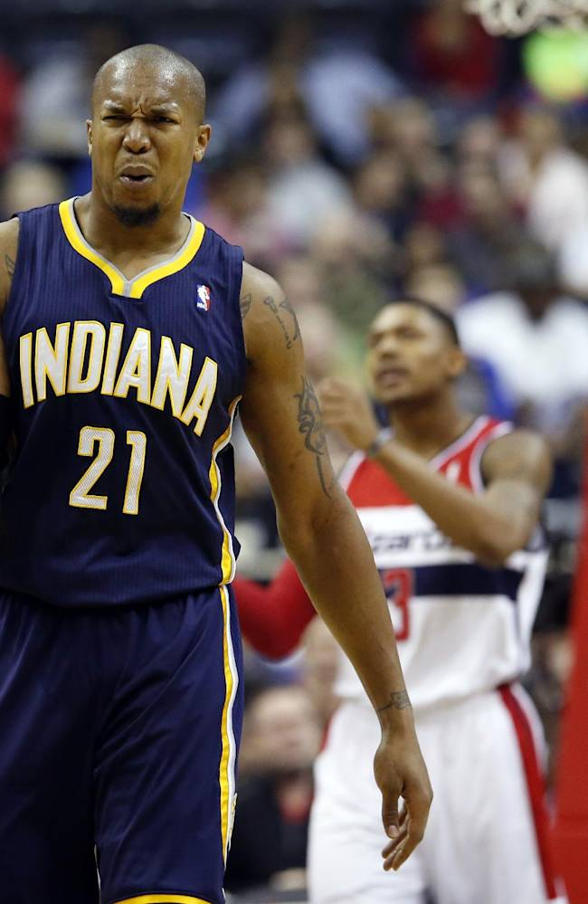 Indiana Pacers forward David West (21) reacts after a foul call in the first half of an NBA basketball game against the Washington Wizards, Friday, March 28, 2014, in Washington