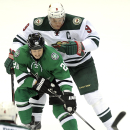 Dallas Stars center Cody Eakin (20) tries to control the puck while defended by Minnesota Wild center Mikko Koivu (9) in the first period of an NHL hockey game, Saturday, Nov. 15, 2014, in Dallas The Associated Press