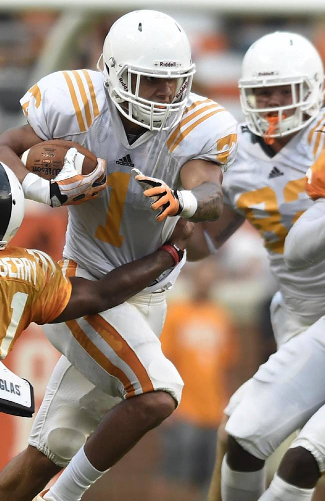 Tennessee running back Jalen Hurd (1) breaks a tackle by Tennessee defensive back Elliott Berry (41) during Tennessee's open practice at Neyland Stadium in Knoxville on Saturday, Aug. 16, 2014