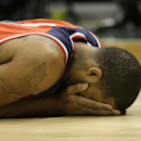 Washington Wizards' Trevor Ariza lies on the floor after being injured against the Milwaukee Bucks during the first half of an NBA basketball game on Saturday, March 8, 2014, in Milwaukee The Associated Press
