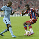 Manchester City's Fernandinho, left, and Bayern's David Alaba challenge for the ball during the Champions League group E soccer match between Bayern Munich and Manchester City in Munich, Germany, Wednesday Sept.17,2014