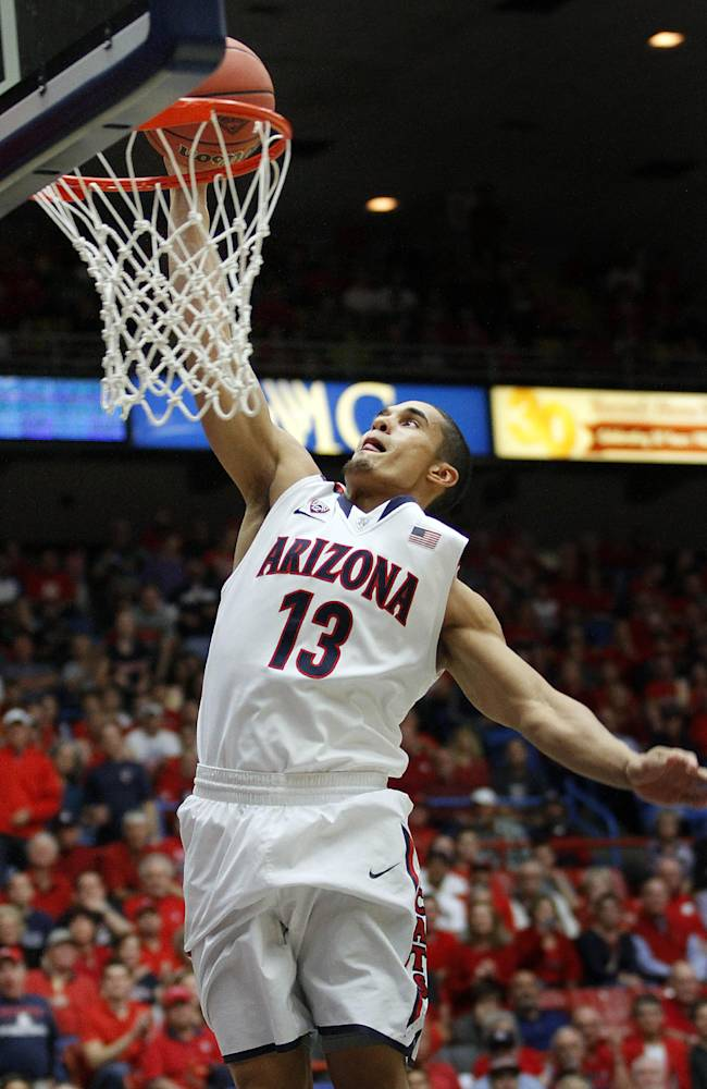 Arizona's Nick Johnson goes to the basket for an easy lay-up against Fairleigh Dickinson in the first half of an college NCAA basketball game, Monday, Nov. 18, 2013 in Tucson, Ariz. This is in the first round of the Preseason NIT