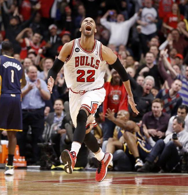 Chicago Bulls forward Taj Gibson (22) celebrates after his dunk off a rebound during the second half of an NBA basketball game against the Indiana Pacers Monday, March 24, 2014, in Chicago. The Bulls won 89-77