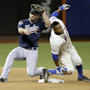 Atlanta Braves' Dan Uggla (26) tags out New York Mets' Eric Young Jr. (22) during the third inning of a baseball game Saturday, April 19, 2014, in New York The Associated Press